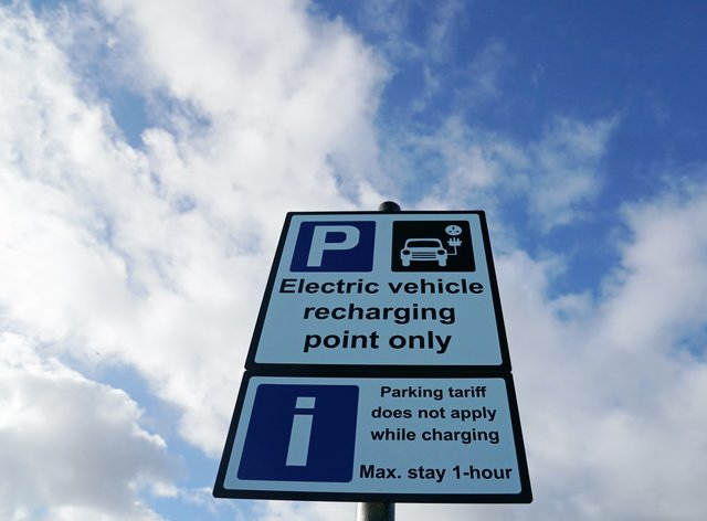More than four out of five drivers believe signs for electric vehicle charge points would be easier to spot if they were green, a new survey suggests (Owen Humphreys/PA)