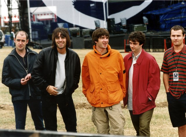 Arthur (left) alongside Liam and Noel before Oasis' famous Knebworth gigs in 1996 (PA Images)