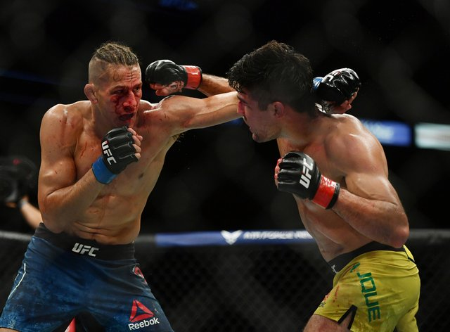 Price (left) was beaten by Vicente Luque after the doctor stepped in to end the contest (PA Images)