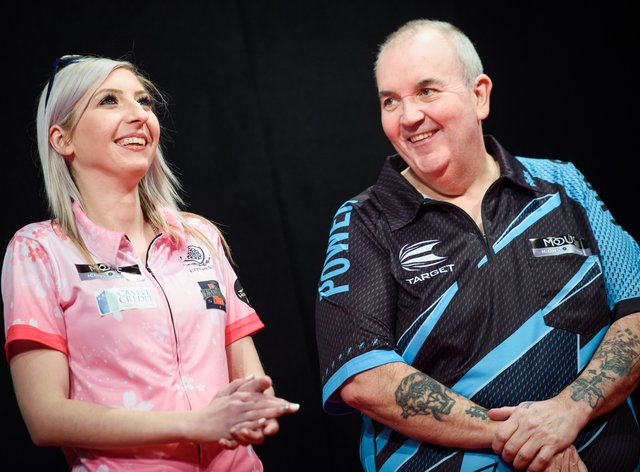 Fallon Sherrock and Phil Taylor battled it out while raising money for charity (PA Images)