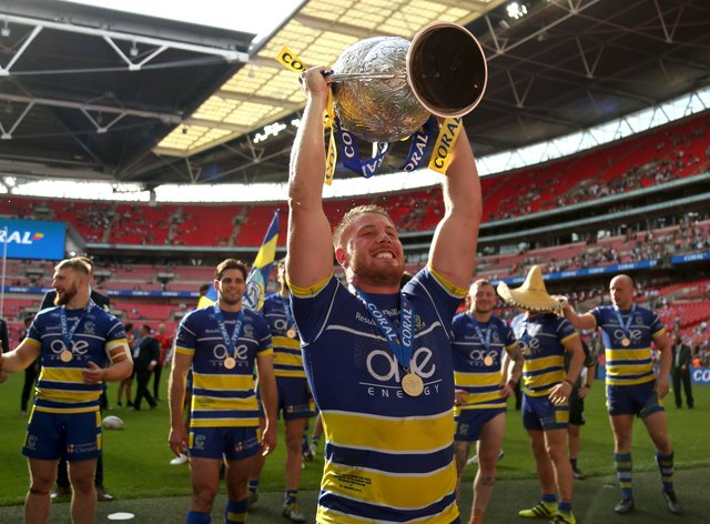 Warrington Wolves celebrate their win last year (PA Images)