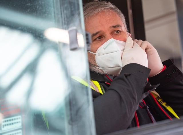 Bus driver adjusts mask