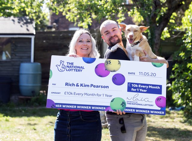 Rich Pearson, 30, and wife Kim, 33, pictured with their rescue dog Loki