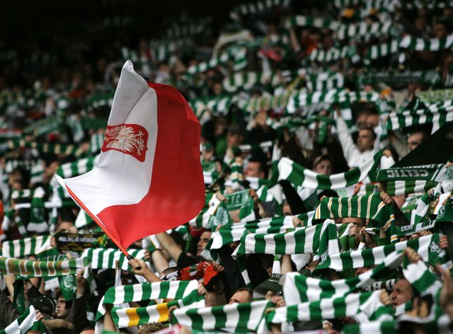 Celtic fans with a Polish flag prior to a football match