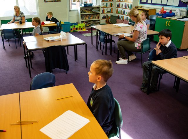 Children of essential workers socially distance whilst in class at Kempsey Primary School in Worcester