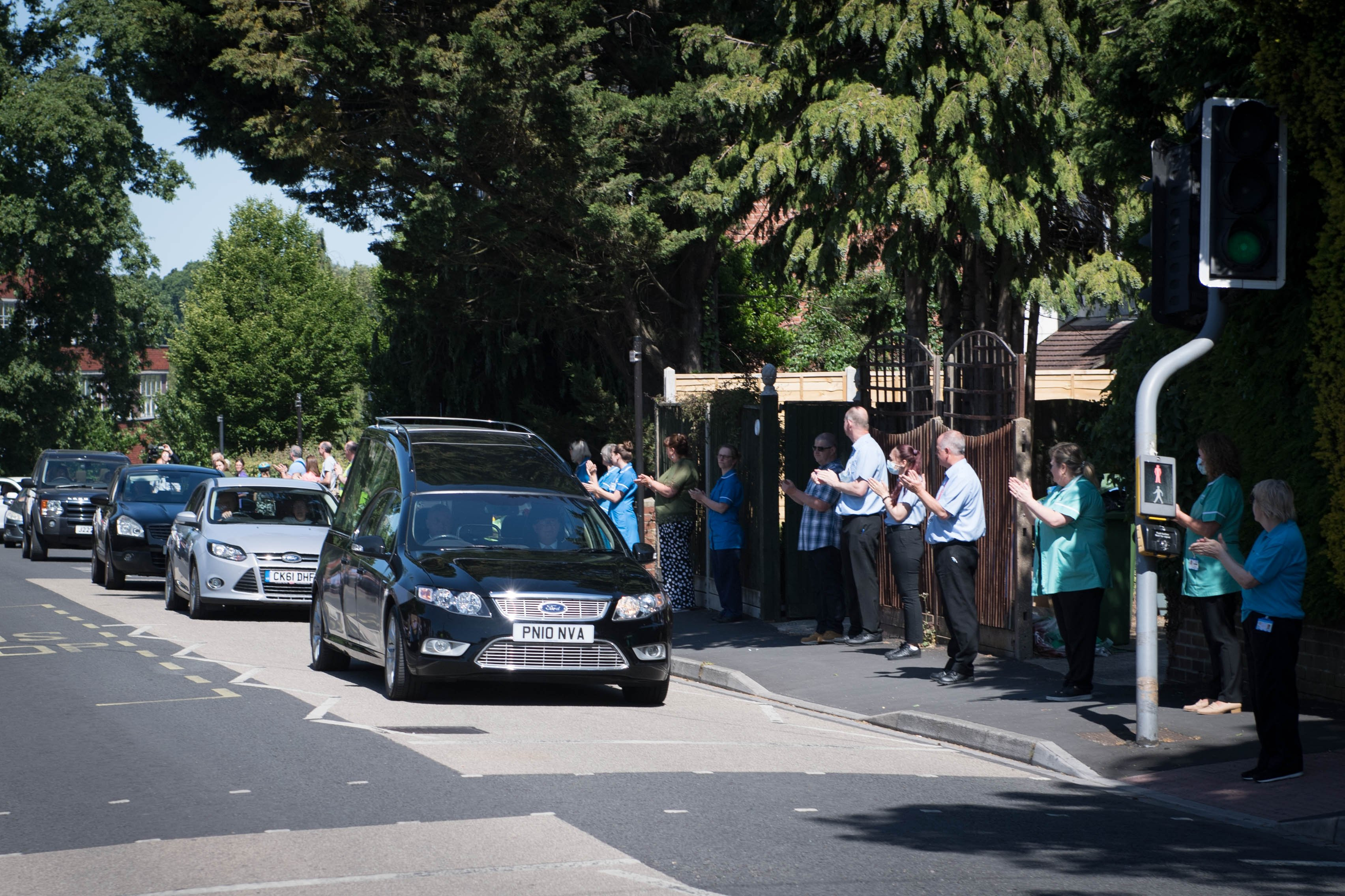 Colleagues line street for funeral procession of 'loved and valued' NHS worker