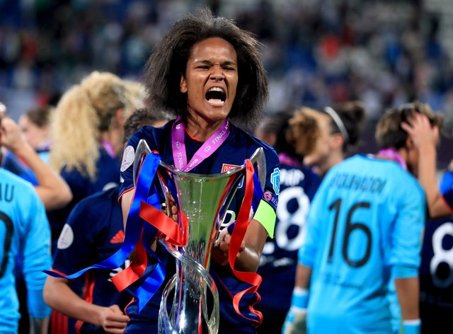 Lyon's Wendie Renard with the Champions League trophy