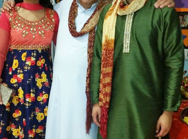 Nassar Hussain (centre) with his daughter Farah and son Adam