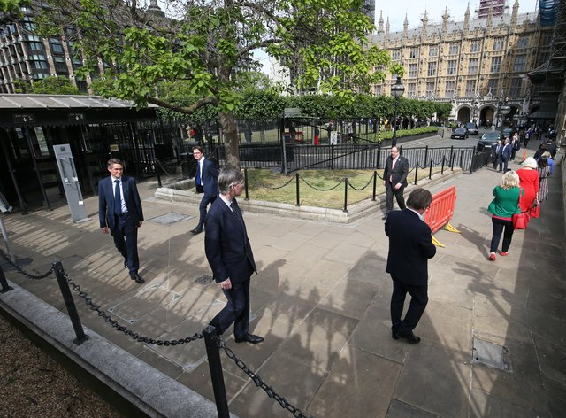 MPs queue outside the Commons as they wait to vote