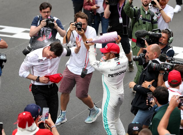 Wolff, left, plans to discuss a new contract with Lewis Hamilton once the F1 season belatedly gets under way