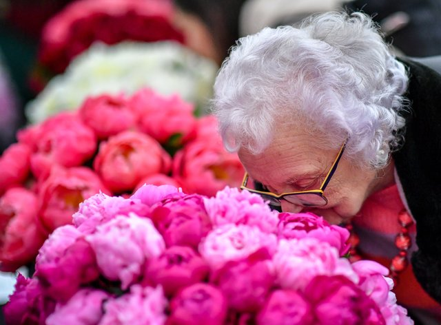 A woman smelling flowers