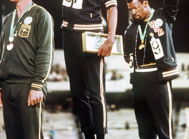 Tommie Smith and John Carlos bowed their heads and raised black-gloved fists in protest at the 1968 Mexico Olympics