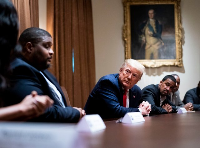 President Donald Trump meets African-American supporters in the Cabinet Room of the White House this week