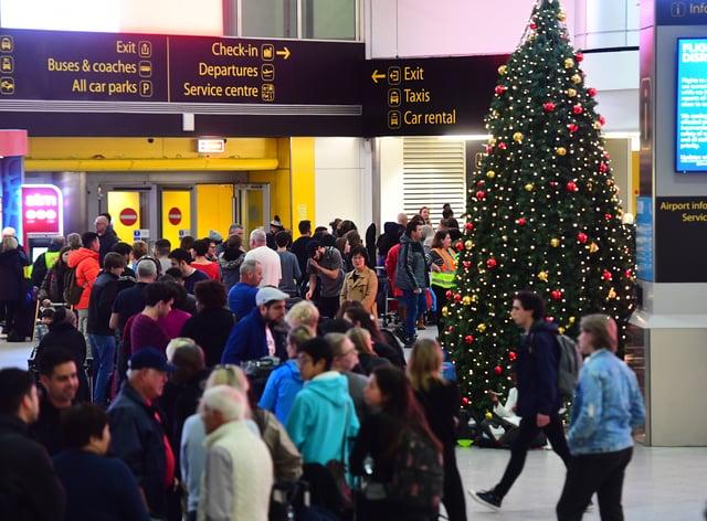Passengers queue for information