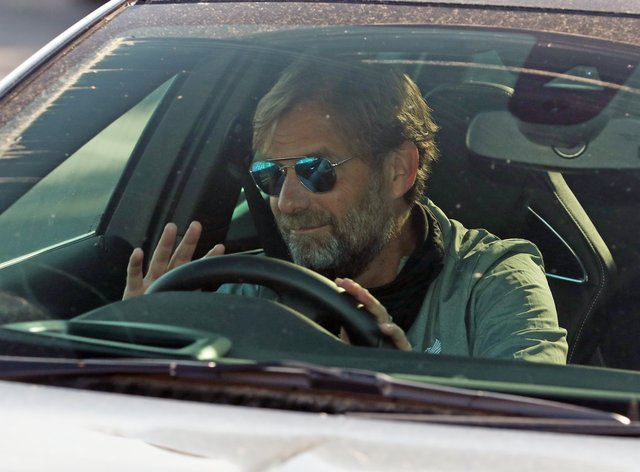 Liverpool manager Jurgen Klopp arrives at the club's Melwood training ground after the Premier League announced players could return to training in small groups.