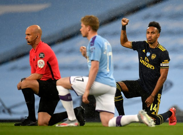 Players in both Premier League games on Wednesday took a knee (Peter Powell/NMC Pool)