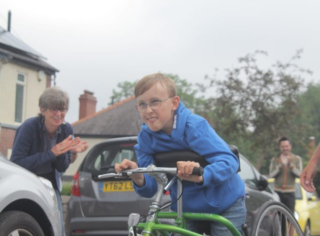 Tobias Weller, nine, beginning his new challenge outside his home in Sheffield