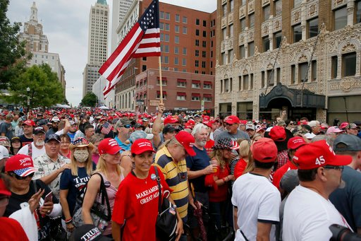President Donald Trump supporters line up to enter a security gate before a rally at the BOK Center in Tulsa