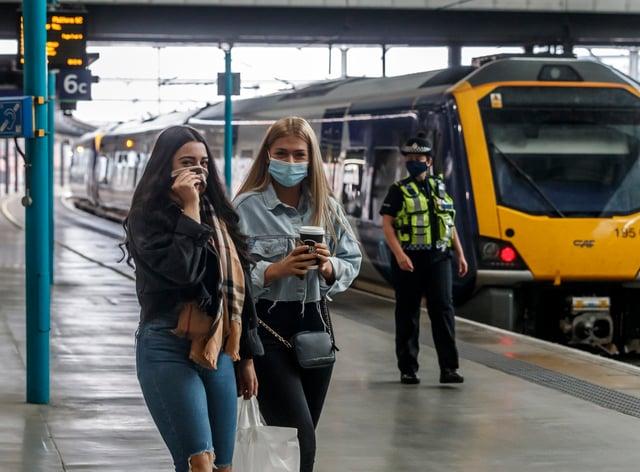 Passengers wearing face masks at Leeds railway station