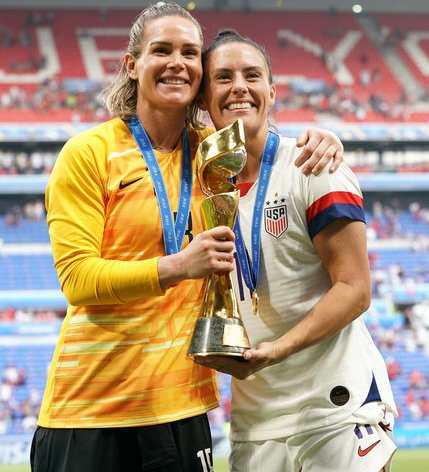 Orlando's Ashlyn Harris and Ali Krieger celebrate with the FIFA Women's World Cup Trophy, but will miss out on the Challenge Cup