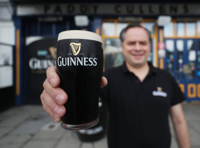 Mariusz Brzyk assistant manager of Paddy Cullens pub in Dublin takes delivery of fresh Guinness (Niall Carson/PA)