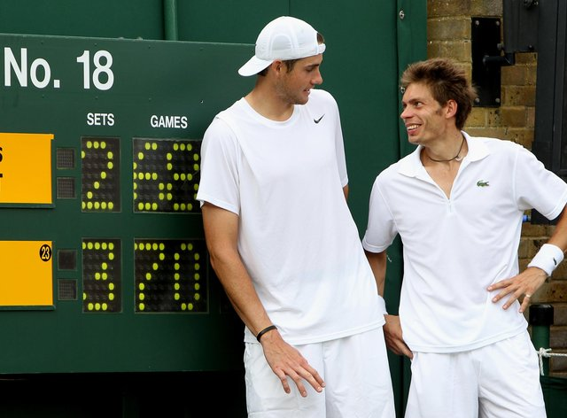 Isner and Mahut, right, re-wrote the record books at Wimbledon on this day in 2010