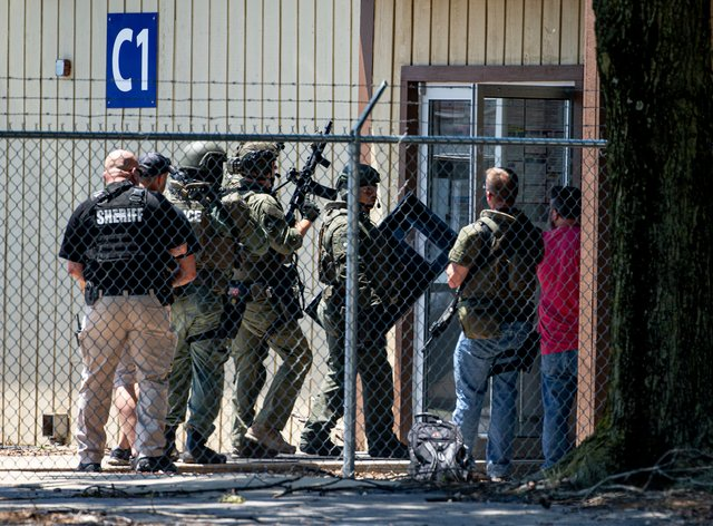 Law enforcement  enter the building after the Illinois shooting