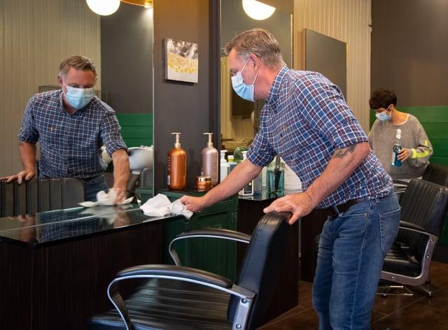 Robin Dignall and Maria Demetriou-Clamp disinfect their hair salon Hair@1RD in Leicester