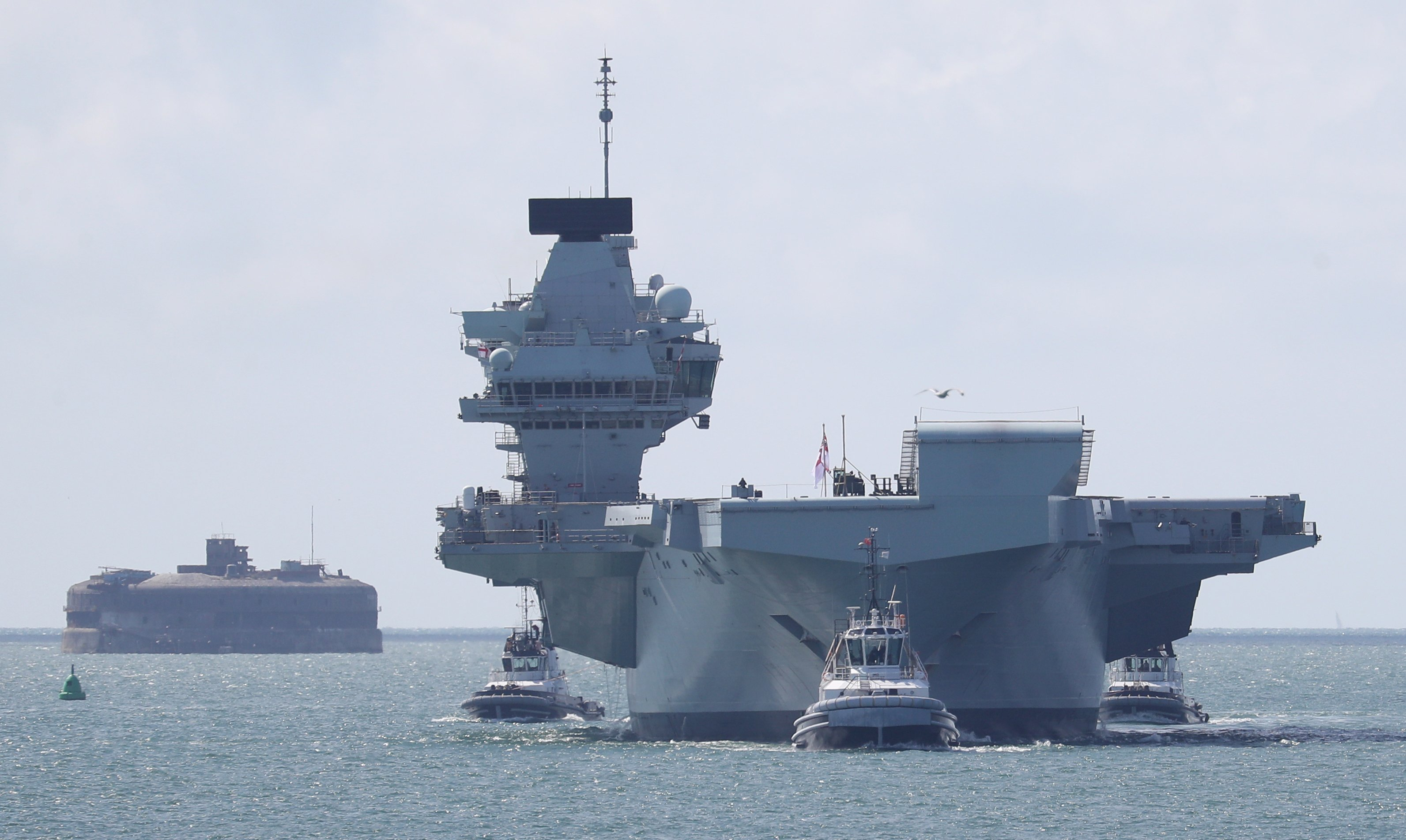 HMS Queen Elizabeth back in home port as 'fully trained' aircraft carrier