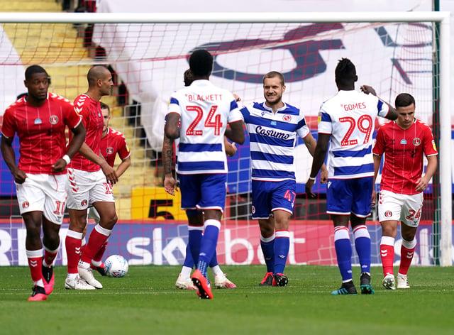 Reading's George Puscas (centre) celebrates scoring