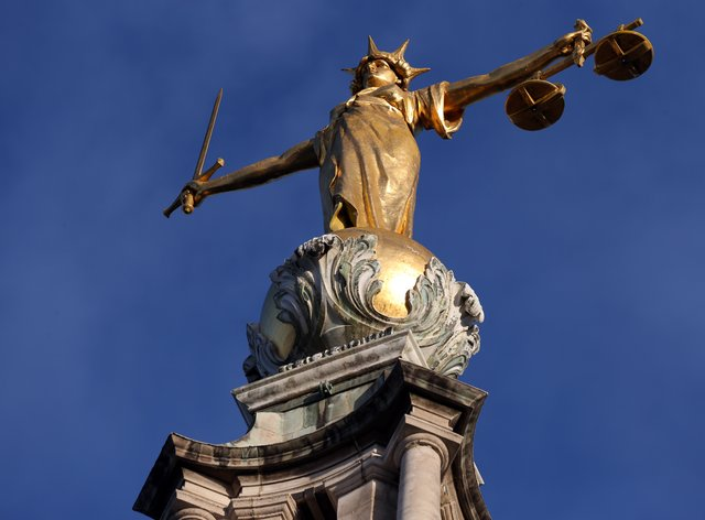 FW Pomeroy's Statue of Justice stands atop the Central Criminal Court (Jonathan Brady/PA)