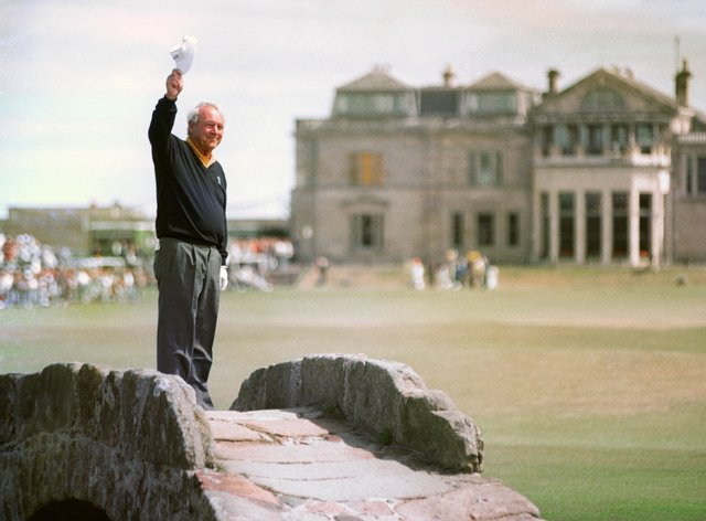 Arnold Palmer waves farewell to St Andrews on the Swilken Bridge at the 1995 Open Championship