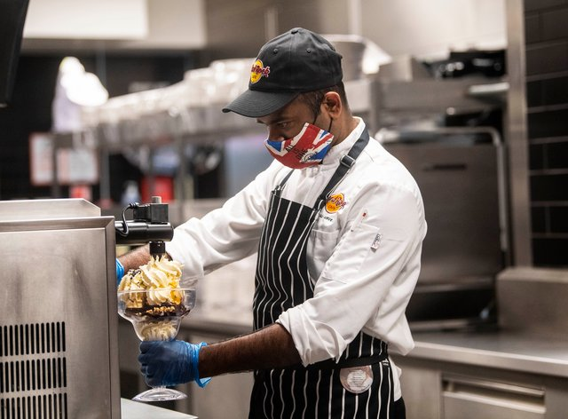 A chef wears PPE