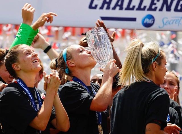 Houston Dash celebrate their maiden trophy