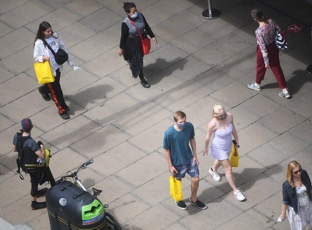 People walk in a public square