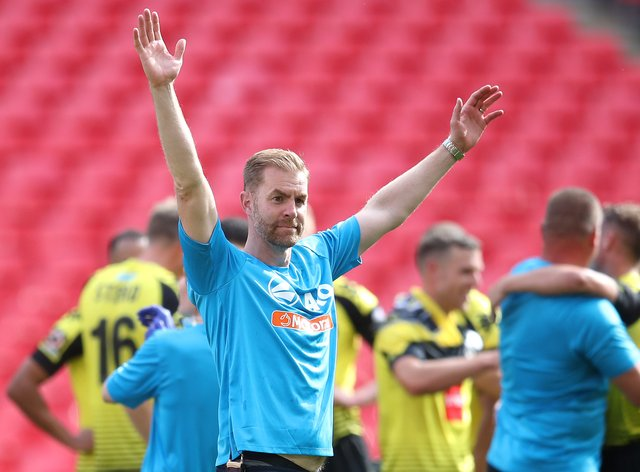 Harrogate Town manager Simon Weaver is celebrating his side's stunning promotion success