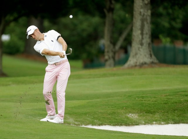 Justin Thomas on his way to a birdie at the 16th hole