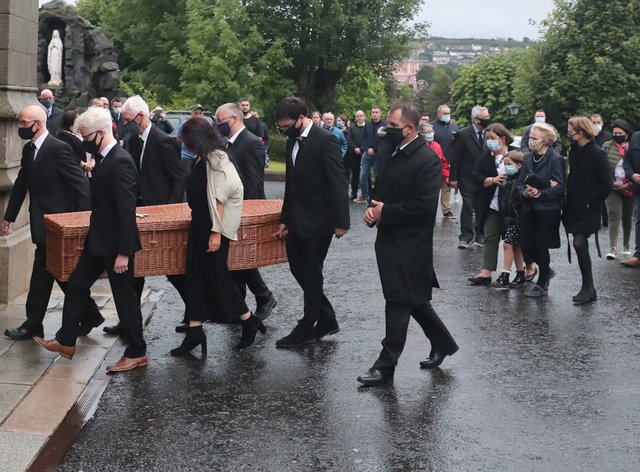 Family members form a guard of honour as the coffin of John Hume is taken into St Eugene's Cathedral in Londonderry