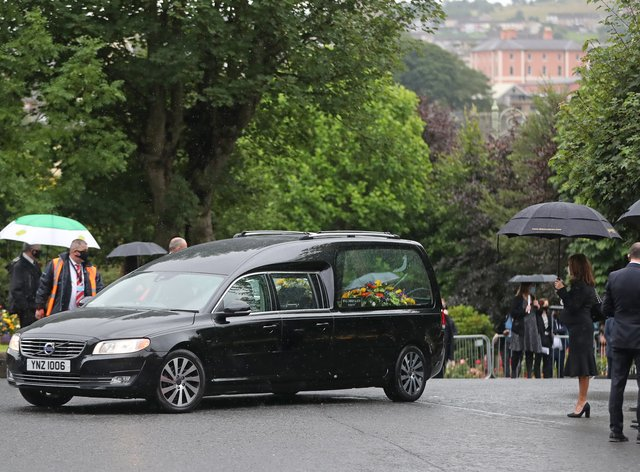 The hearse carrying the body of John Hume arrives at St Eugene's Cathedral