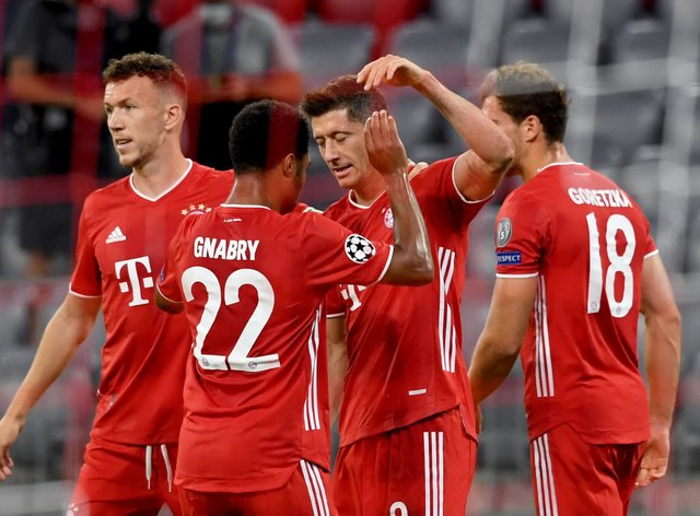 Robert Lewandowski, centre right, celebrates his first goal
