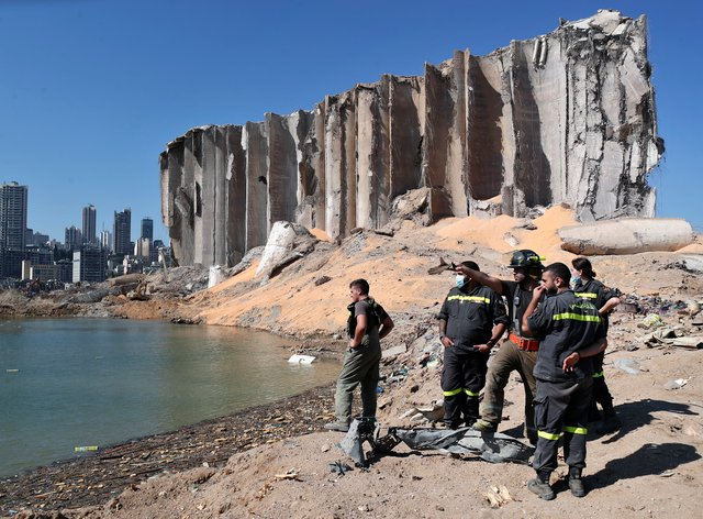 A rescue team surveys the site of the massive explosion in the port of Beirut, Lebanon