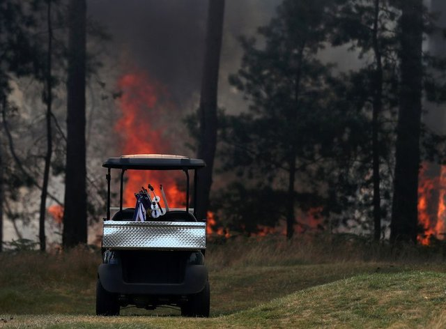 The fires proved too furious to put out in time for play to resume on Saturday