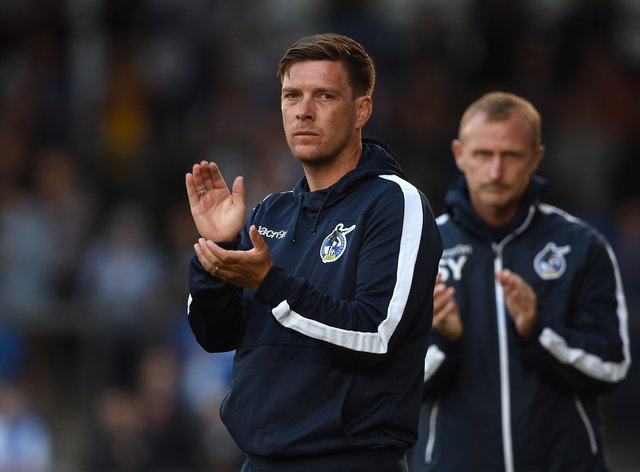 Darrell Clarke (pictured) has brought Rory Holden back to Walsall