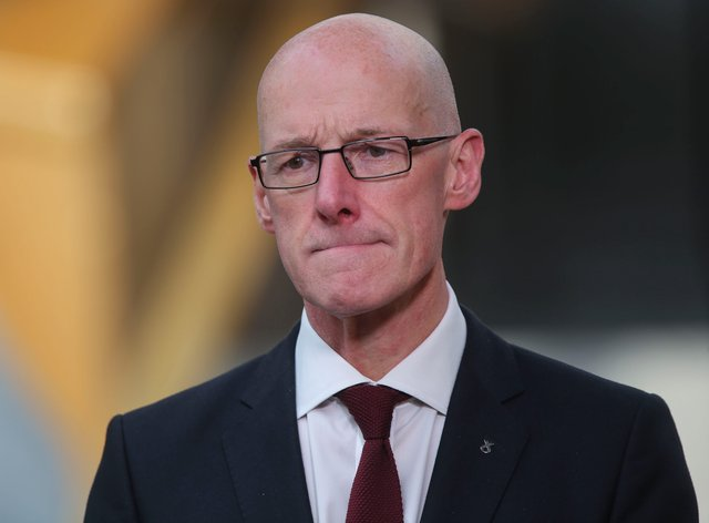 Scotland's Education Secretary John Swinney gives a ministerial statement on SQA exam results at the Scottish Parliament