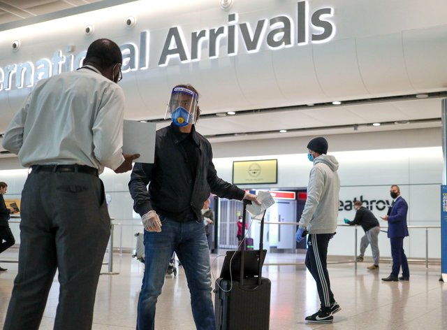 Passengers arrive at Terminal 2 at Heathrow Airport in London (Steve Parsons/PA)