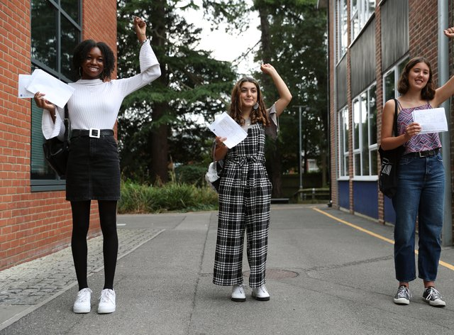 Students Gabrielle Josephs, left, Sara Al Soodi and Miriam Wilson after receiving their A-level results at Peter Symonds College, Winchester