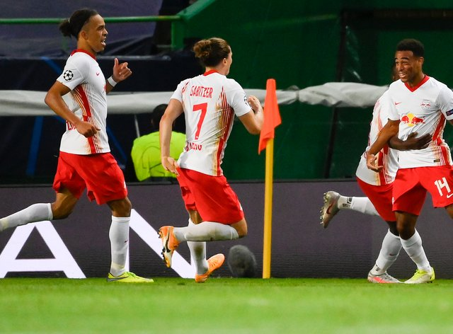 Tyler Adams, right, celebrates with team-mates