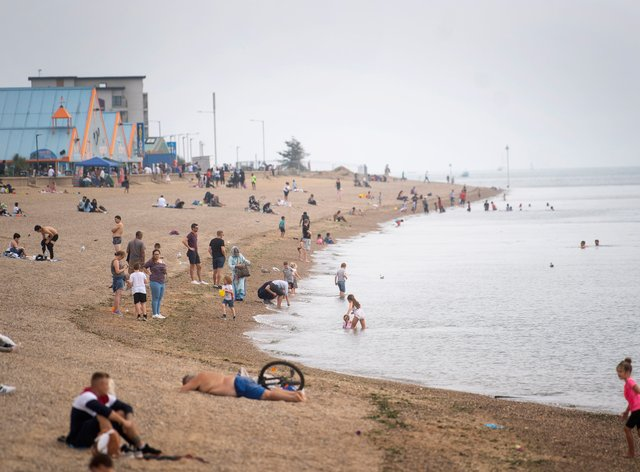 Visitors enjoy the beach at Southend, Essex
