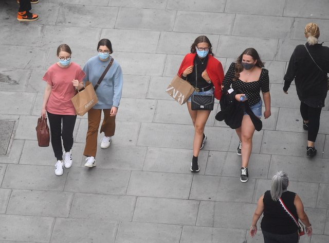 People wearing face masks while shopping