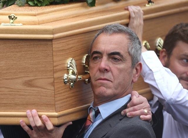 Actor James Nesbitt carries his father's coffin